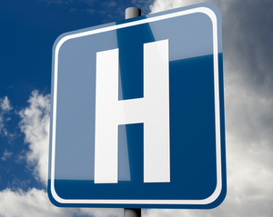 Hospital Sign in Clouds Representing the Best Hospitals Announced