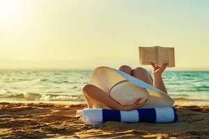 Looking for a few good beach reads for your summer travel assignment? We've got you covered!